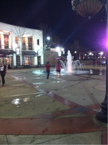 Running through the fountain in celebration.